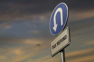 Tax refund U-Turn sign.